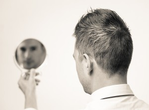 The Mirror in Leadership. Businessman Looking In The Mirror And Reflecting