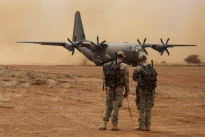 British RAF Hercules aircraft on airstrip  - Liberating Leadership in action